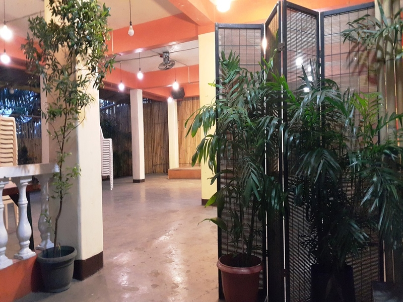 high ceiling party space in navotas with room divider and plants around