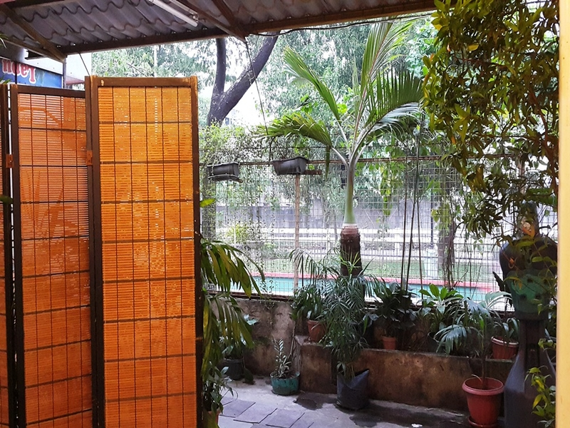navotas private event space with room divider and mini garden