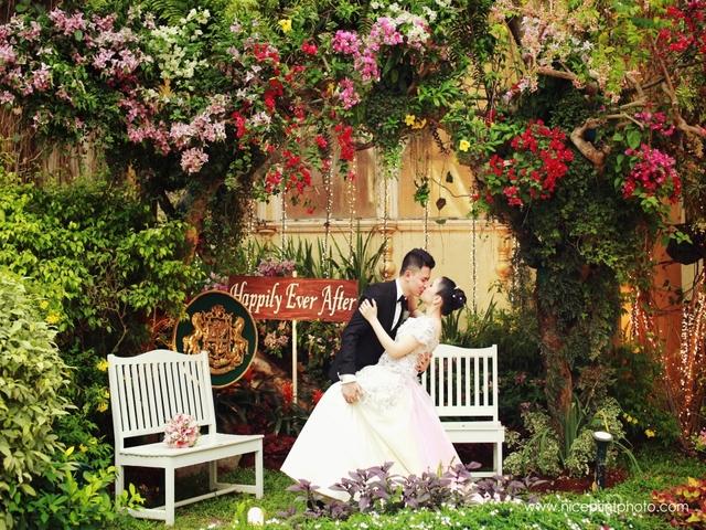couple dancing in garden; flower arch
