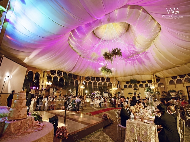 guests dining in wedding hall; three layered cake