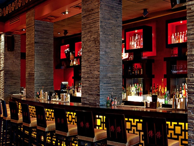 world class feel of bar area with various selection of spirits
