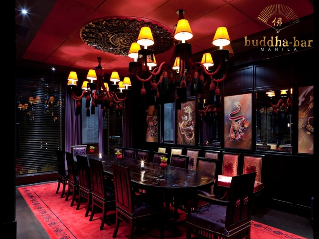 private dining room with red domnated interior and dragon paintings on the wall