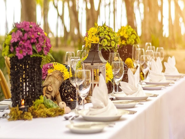 outdoor fine dining table with cutleries and flower centrepieces