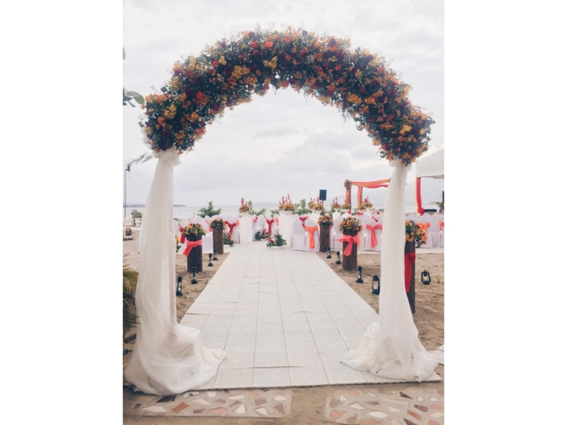 outdoor wedding space in zambales with white aisle and flower decoration