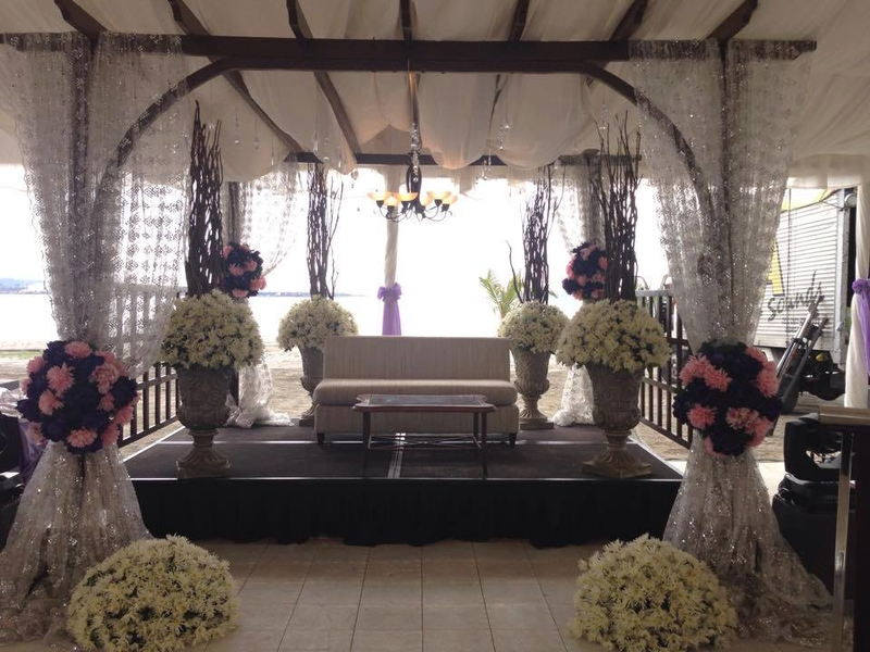 zambales blessing event space with white decoration and mini stage