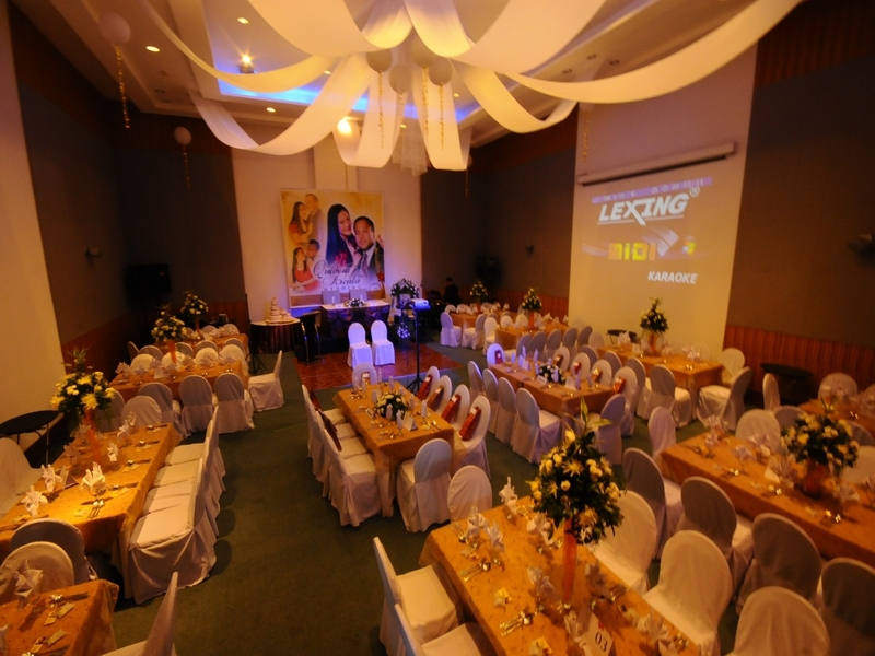 philippines indoor wedding hall with long dining tables and projector screen