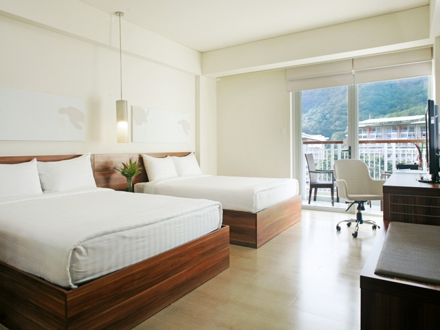 hotel rooms with two large beds