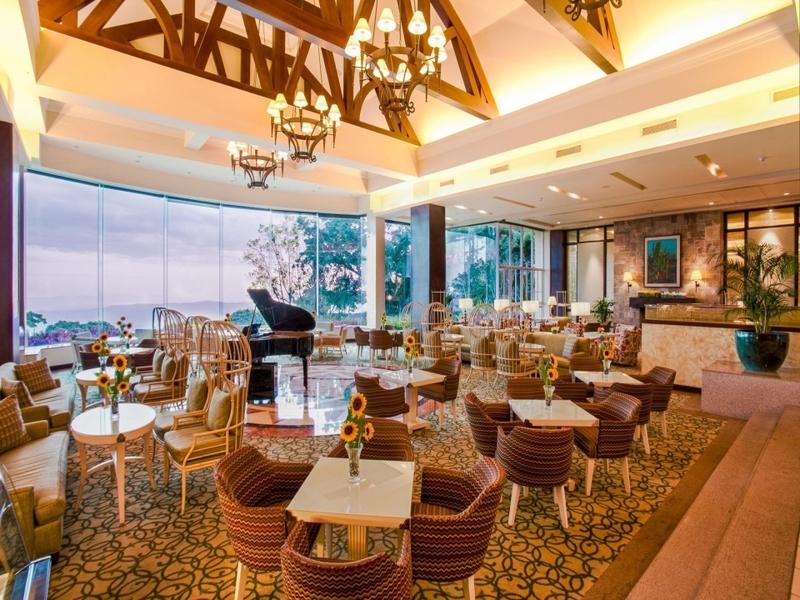 luxury lounge area with ceiling to floor window