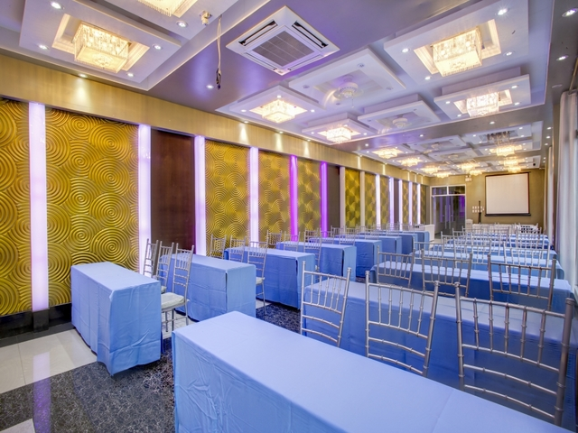 empty event hall with table and chair setup