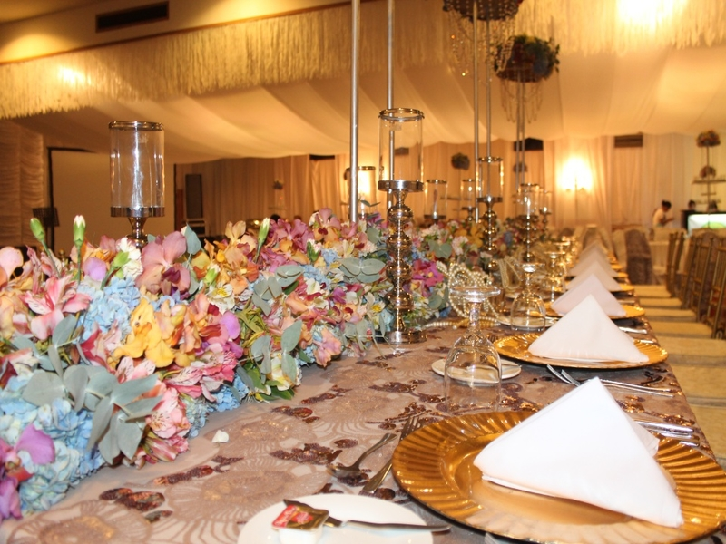 anniversary party venue in davao city with long table set up and flower decorations