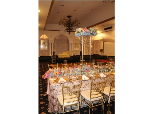 large wedding hall in davao city with standing flower decorations and mini stage
