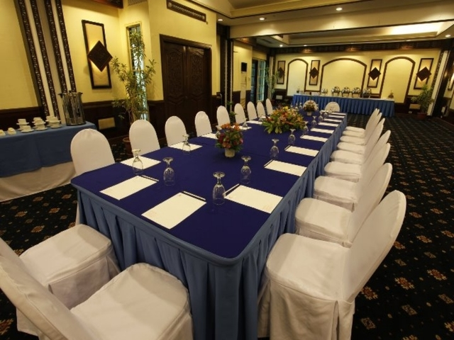 davao city private meeting space with long blue table and white audience chairs