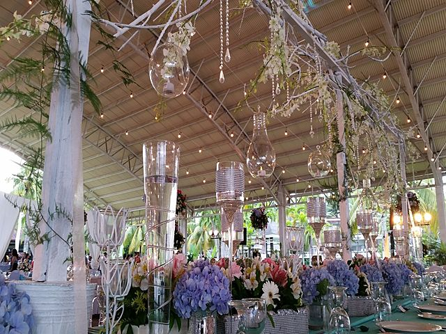 flower decorations with pendant lamp in high ceiling event venue philippines