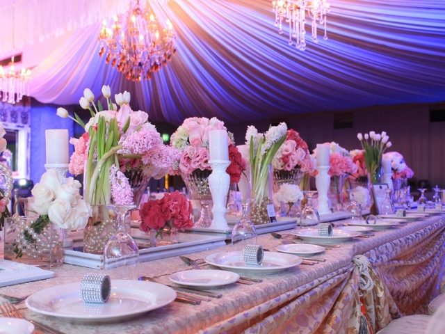 philippines 50th birthday party venue decorated with pink flowers and crystal pendant lamps