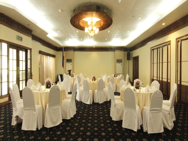 private dining space in davao city with white round tables and patterned black floors