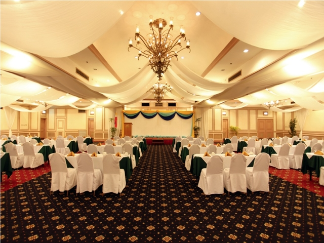 high ceiling seminar event venue in philippines with mini stage and white audience chairs