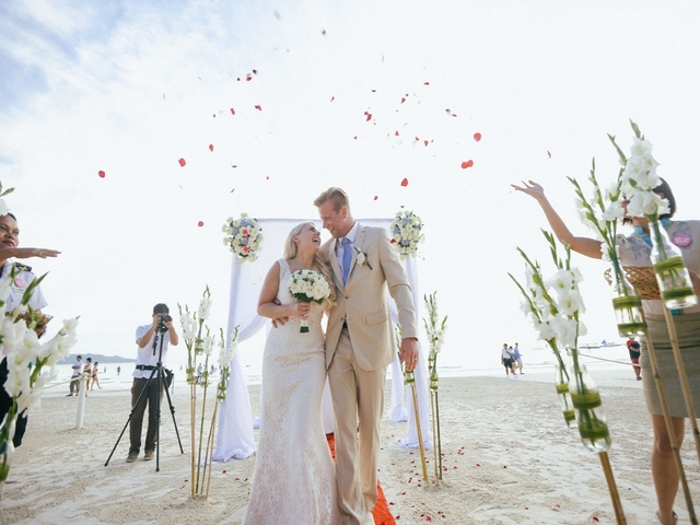 couples are celebrate their beach wedding party