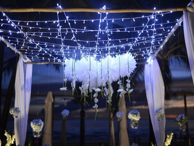 the decoration of lighting for beach wedding party