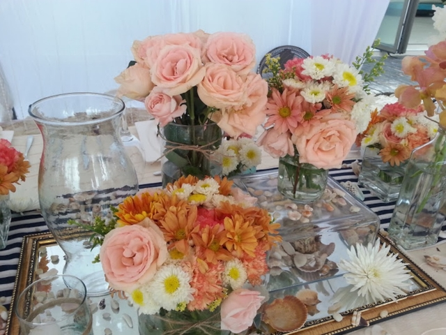 table decoration using pink and orange flowers