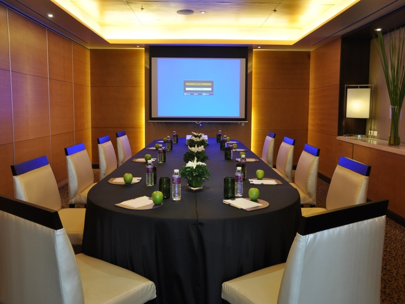 large meeting room with projector screen