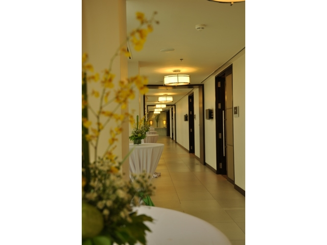 flower decoration in hallway leading to guest rooms