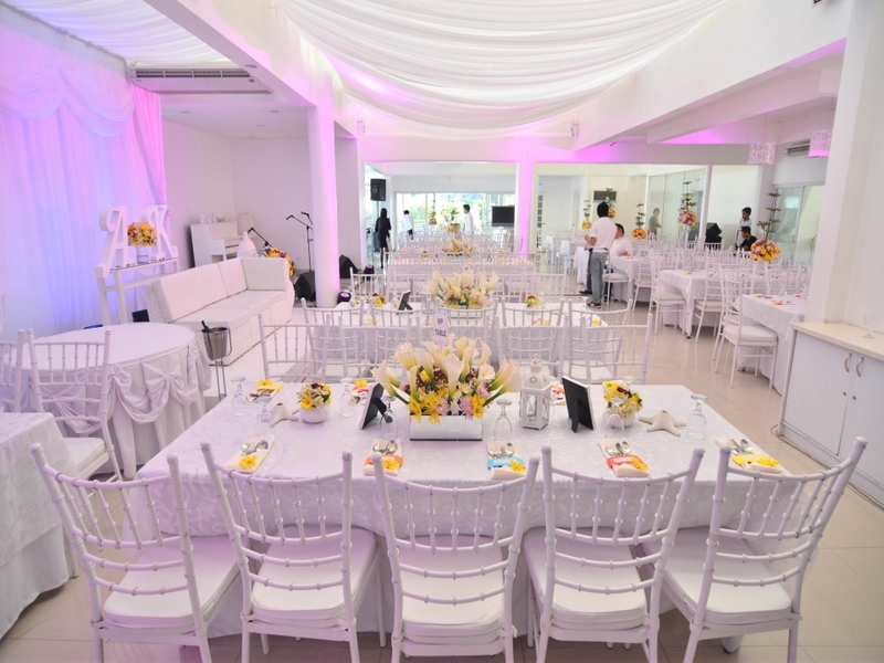 long dining table setup with flower centrepiece