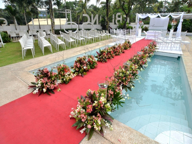 floating stage above pool; red carpet