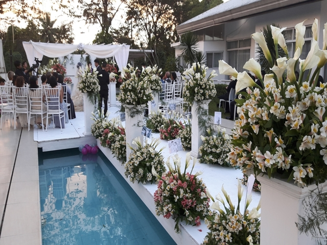 floating aisle with flower arrangement