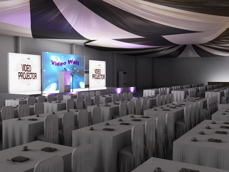 function hall with classroom table setup and stage