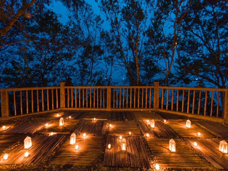 outdoor deck with romantic sky view and lighting