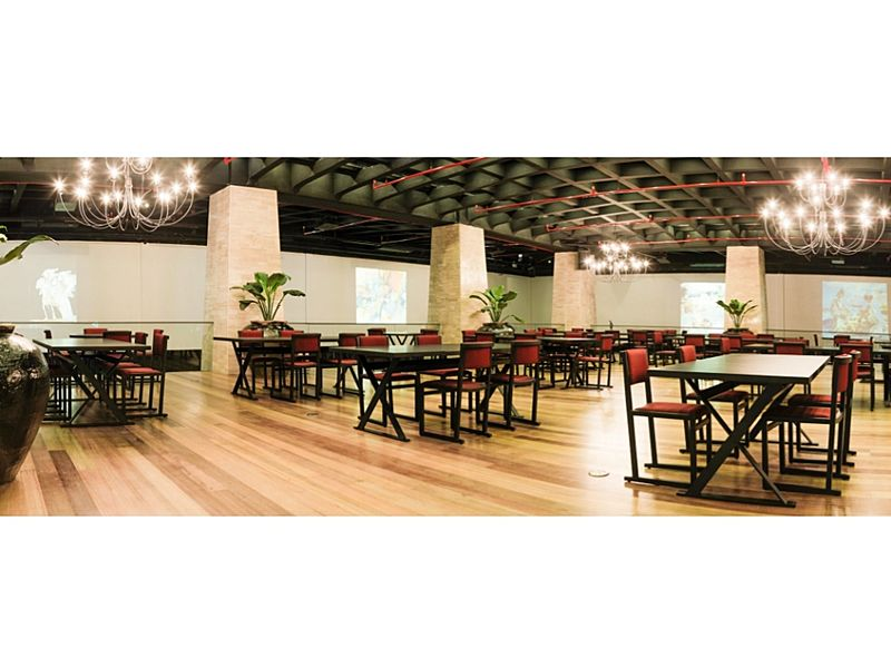 event space with gleaming chandeliers and wooden floor