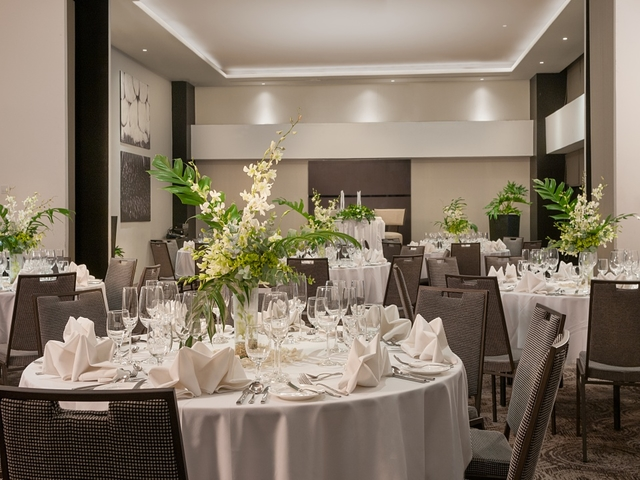 dinner tables with flower centrepiece