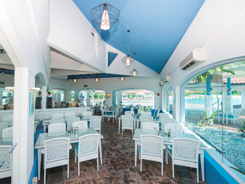 santorini themed restaurant in singapore with white and blue wall