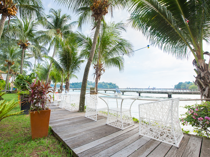 romantic ambience venue in singapore with sea view and coconut tree surrounds