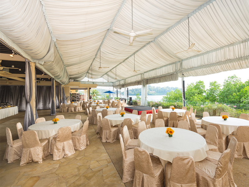 dinner and dance event space with white tent and round tables