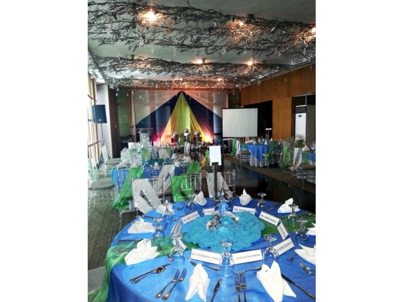 corporate party using banquet style with stage and backdrop