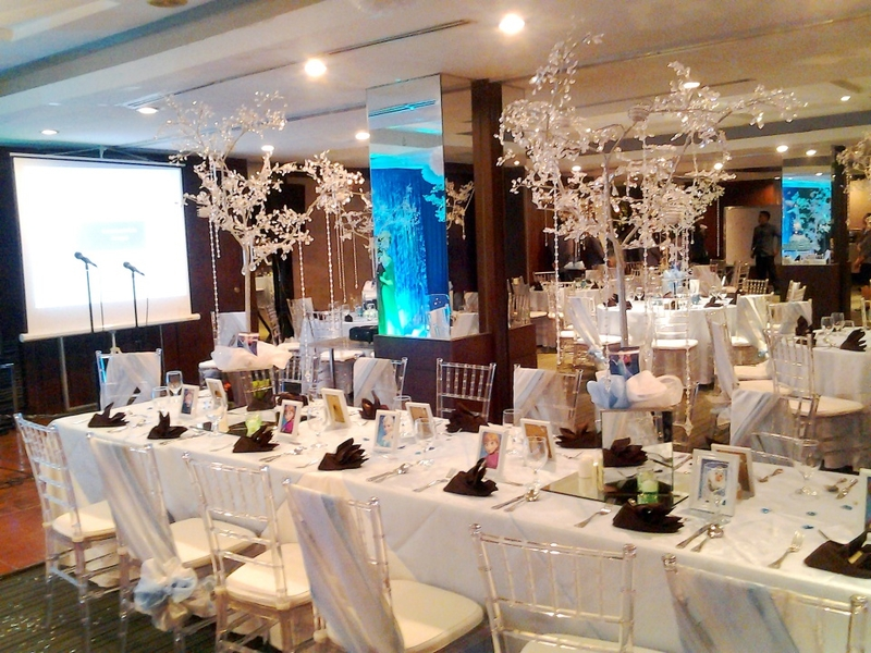 wedding reception setup with decoration on the table