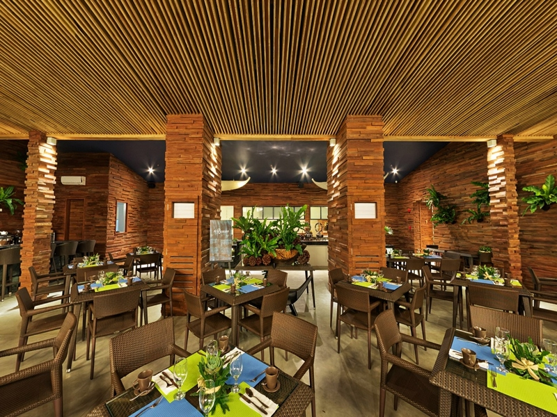 main restaurant area dominated with brick and wooden interior