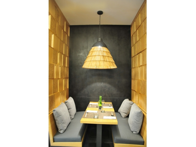dining seats with rattan chandelier and wall