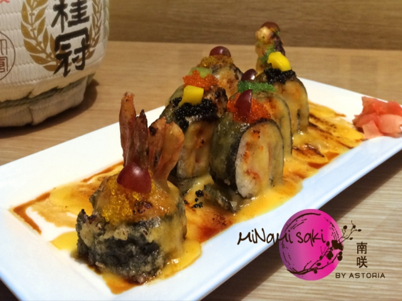 sushi roll drenched in sauce