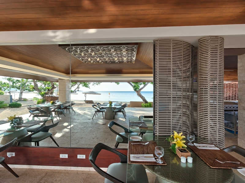 semi outdoor restaurant with the view of the beach and sea