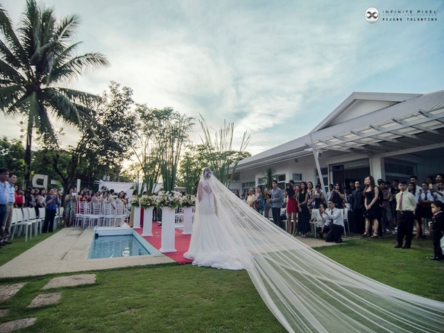 outdoor wedding ceremony with bridge and guests
