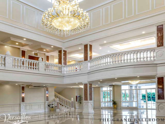 two floors wedding venue in philippines with white interior and crystal lamps
