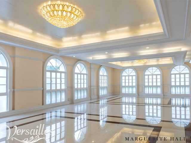 large white event venue in philippines with several windows and crystal lamps