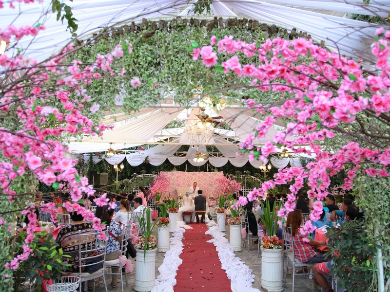 wedding solemnisation event at the outdoor area surrounded with flowers and trees