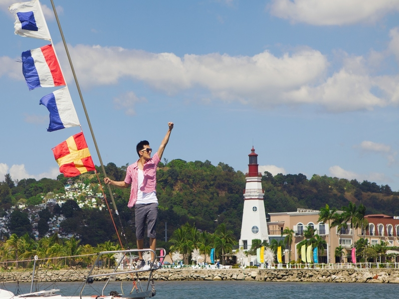 a men doing sailing with big yacht in philippines sea