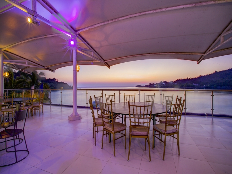santiago christmas event space with sea view and round dining tables