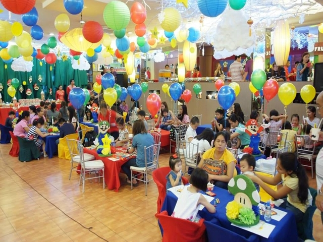 families with kids gathering in different tables during birthday party