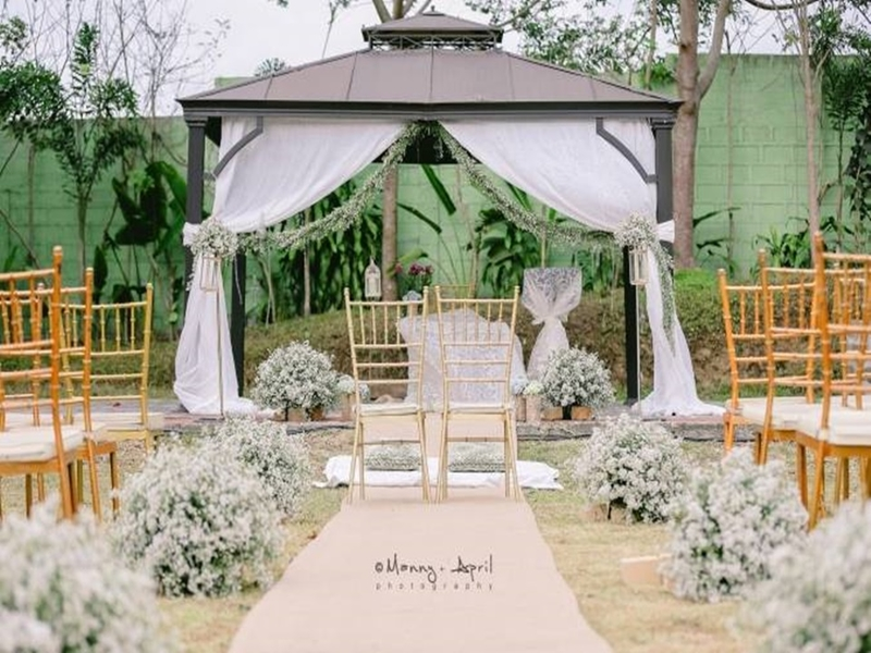 outdoor intimate wedding venue in philippines with white decoration and garden area