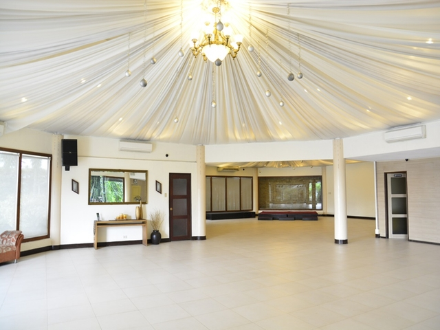 black and white wedding hall in philippines with round-shaped and high ceiling